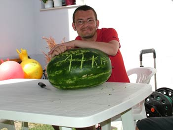 Milan with a giant water melon